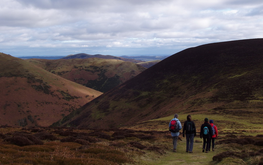 walking on the Long Mynd with views towards the Stretton hills